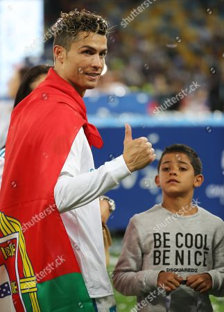 Cristiano Ronaldo of Real Madrid and his son Cristiano Ronaldo Jr. celebrate after the UEFA Champions League final between Real Madrid and Liverpool FC at the NSC Olimpiyskiy stadium in Kiev, Ukraine, 26 May 2018. Madrid won 3-1.