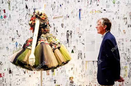 A visitor looks at a creation on display during the opening of the large exhibition 'Viktor&Rolf: fashion Artists 25 Years' in the Kunsthal in Rotterdam, the Netherlands, 26 May 2018. On the occasion of the twenty-fifth anniversary of the Dutch luxury fashion house Viktor&Rolf, the Kunsthal organizes this exhibition in collaboration with the Dutch designers and Canadian curator Thierry-Maxime Loriot.