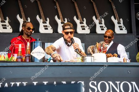 Snoop Dogg, Michael Voltaggio, Warren G. Snoop Dogg, from left, Michael Voltaggio and Warren G seen at the Williams Sonoma Culinary stage at the Bottle Rock Napa Valley Music Festival at Napa Valley Expo, in Napa, Calif