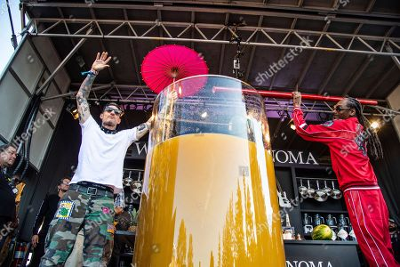 Michael Voltaggio, Snoop Dogg. Michael Voltaggio, left, and Snoop Dogg pose after breaking the world record for the largest paradise cocktail at the Williams Sonoma Culinary stage at the Bottle Rock Napa Valley Music Festival at Napa Valley Expo, in Napa, Calif