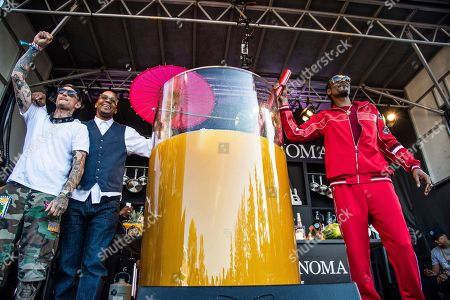Michael Voltaggio, Warren G, Snoop Dogg. From left to right, Michael Voltaggio, Warren G and Snoop Dogg pose after breaking the world record for the largest paradise cocktail at the Williams Sonoma Culinary stage at the Bottle Rock Napa Valley Music Festival at Napa Valley Expo, in Napa, Calif