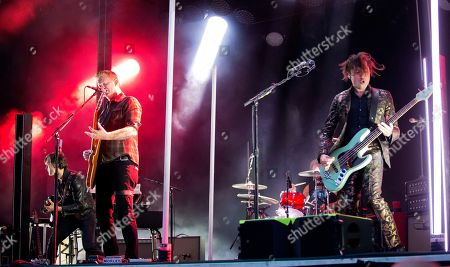 Stock Picture of Troy Van Leeuwen, Josh Homme, Michael Shuman. Troy Van Leeuwen, from left, Josh Homme and Michael Shuman of Queens Of The Stone Age perform at the Boston Calling Music Festival, in Allston, Mass
