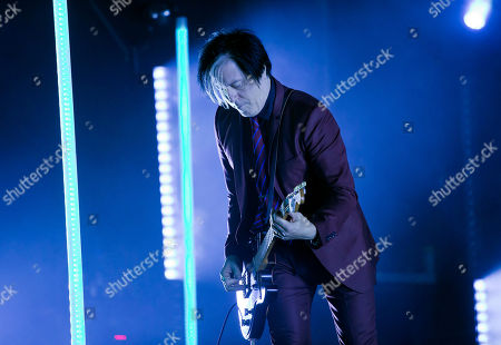 Queens Of The Stone Age guitarist Troy Van Leeuwen performs at the Boston Calling Music Festival, in Allston, Mass