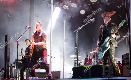 Troy Van Leeuwen, Josh Homme, Michael Shuman. Troy Van Leeuwen, from left, Josh Homme and Michael Shuman of Queens Of The Stone Age perform at the Boston Calling Music Festival, in Allston, Mass