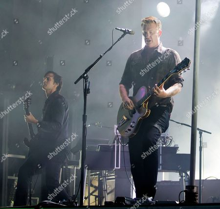 Troy Van Leeuwen, Josh Homme. Troy Van Leeuwen, from left, and Josh Homme of Queens Of The Stone Age perform at the Boston Calling Music Festival, in Allston, Mass