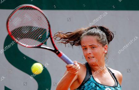 Slovakia's Viktoria Kuzmova returns the ball to Italy's Francesca Schiavone during the French Open tennis tournament at the Roland Garros Stadium, in Paris