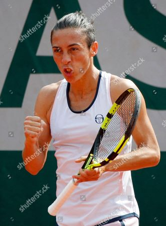 Italy's Francesca Schiavone clenches her fist as she plays Slovakia's Viktoria Kuzmova during the French Open tennis tournament at the Roland Garros Stadium, in Paris