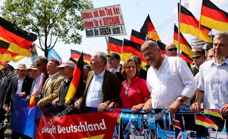 Georg Pazderski (5-L), Chairman of Berlin section of German right-wing 'Alternative for Germany' (AfD) party, AfD co-leader Alexander Gauland (4-R), Beatrix von Storch of AfD (3-R) and AfD co-leader Joerg Meuthen (2-R) take part in a march of the 'Alternative for Germany' (AfD) party in Berlin, Germany, 27 May 2018. The AfD has called for a large demonstration under the motto 'Future Germany' (Zukunft Deutschland) to which they expect more than 5,000 participants. Various alliances of parties, cultural workers and civil society have organized counter-demonstrations and rallies, which are also expected to attract more than 10,000 participants.