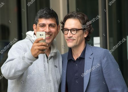 Stock Picture of Actor, Ben Chaplin, leaves the BBC studios after having appeared on 'The Andrew Marr Show'.