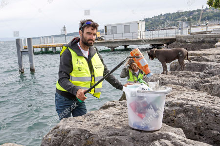 Switzerland's skipper Alan Roura, with his girlfriend Aurelia Mouraud and his dog Louna during the ninth edition of the 'Net'Leman' lake cleaning event, in Geneva, Switzerland, 27 May 2018. Over a thousand volunteers took part in the annual lake cleanup event.