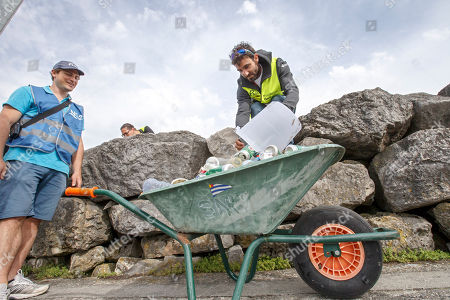 Switzerland's skipper Alan Roura collects garbage in the Geneva harbor of the Lake of Geneva during the ninth edition of the 'Net'Leman' lake cleaning event, in Geneva, Switzerland, 27 May 2018. Over a thousand volunteers took part in the annual lake cleanup event.