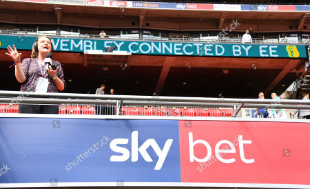 Radio reporter and Fulham fan Emma Jones on duty at Wembley