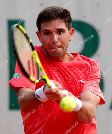 Federico Delbonis of Argentina in action against Thomaz Bellucci of Brazil during their men?s first round match during the French Open tennis tournament at Roland Garros in Paris, France, 27 May 2018.