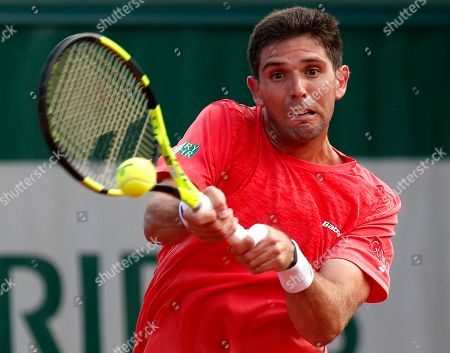 Stock Picture of Federico Delbonis of Argentina in action against Thomaz Bellucci of Brazil during their men?s first round match during the French Open tennis tournament at Roland Garros in Paris, France, 27 May 2018.