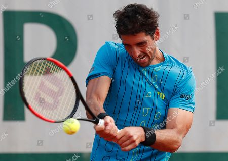 Stock Photo of Thomaz Bellucci of Brazil in action against Federico Delbonis of Argentina during their men?s first round match during the French Open tennis tournament at Roland Garros in Paris, France, 27 May 2018.