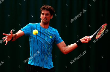 Thomaz Bellucci of Brazil in action against Federico Delbonis of Argentina during their men?s first round match during the French Open tennis tournament at Roland Garros in Paris, France, 27 May 2018.