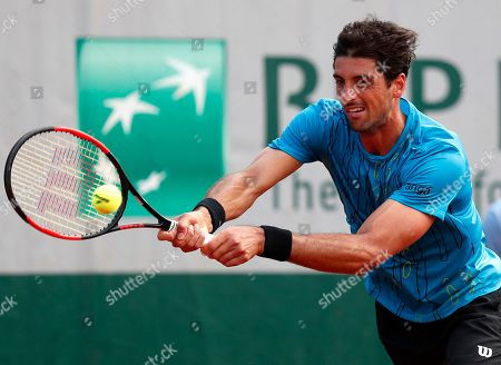 Stock Image of Thomaz Bellucci of Brazil in action against Federico Delbonis of Argentina during their men?s first round match during the French Open tennis tournament at Roland Garros in Paris, France, 27 May 2018.