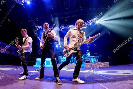 Stock Photo of Members of British band Status Quo, singer Francis Rossi (L), bassist John 'Rhino' Edwards (R) and guitarist Richie Malone perform during their concert in Las Palmas de Gran Canaria as part of the Legedns Live festival in Canary islands, Spain, 26 May 2018 (issued on 27 May).