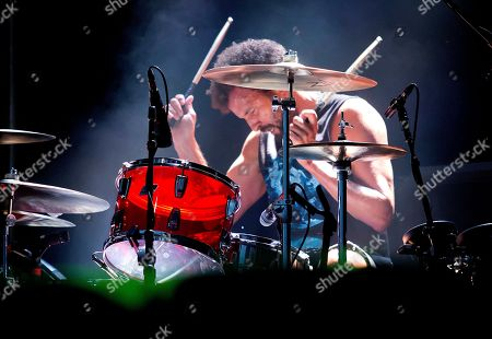 Stock Photo of Drummer Jon Theodore performs with Queens Of The Stone Age at the Boston Calling Music Festival, in Allston, Mass