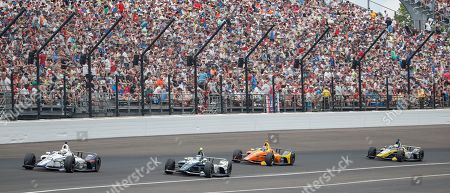 Canadian driver Zachary Claman DeMelo of Dale Coyne Racing (L), British driver Max Chilton of Carlin (2-L), US driver Zach Veach of the Andretti Autosports (2-R) and US driver Charlie Kimball of Carlin (R) compete during the 102nd running of the Indianapolis 500 auto race at the Indianapolis Motor Speedway in Indianapolis, Indiana, USA, 27 May 2018.