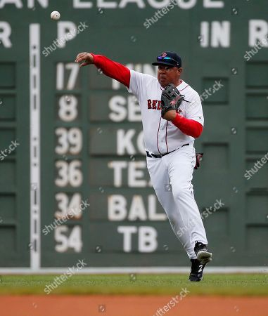 Former Boston Red Sox's Darren Lewis throws to the infield during a Red Sox alumni baseball game, in Boston