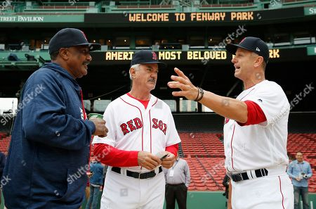 Jim Rice, Dwight Evans, Scott Cooper. Former Boston Red Sox players, from left, Jim Rice, Dwight Evans and Scott Cooper talk before a Red Sox alumni baseball game, in Boston