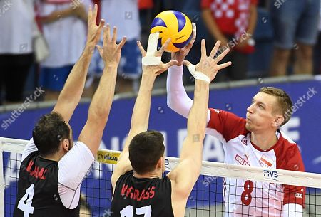 Damian Schulz (R) of Poland in action against Nicholas Hoag (L) and Graham Vigrass (C) of Canada during FIVB Volleyball Nations League tournament and match between Poland and Canada in Krakow, Poland, 27 May 2018.