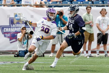 Foxborough, MA, U.S. - Noah Taylor (#20) works against Christian Cropp (#34) as Yale defeats UAlbany 20-11 in the NCAAA semifinal game at Gillette Stadium,