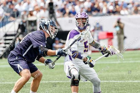 Foxborough, MA, U.S. - Connor Fields (#5) on attack as Yale defeats UAlbany 20-11 in the NCAAA semifinal game at Gillette Stadium,