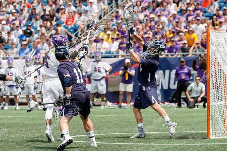 Foxborough, MA, U.S. - Connor Fields (#5) shoots from close range as Yale defeats UAlbany 20-11 in the NCAAA semifinal game at Gillette Stadium,