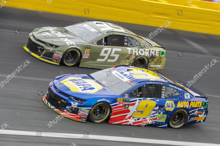 Monster Energy NASCAR Cup Series drivers Chase Elliott (9) and Kasey Kahne (95) race for position off of turn four during the Coca-Cola 600 in Concord, NC