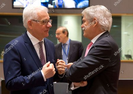 Polish Foreign Minister Jacek Czaputowicz, left, speaks with Spanish Foreign Minister Alfonso Dastis Quecedo during a meeting of EU foreign ministers at the Europa building in Brussels on . EU foreign ministers on Monday were seeking to protect the bloc's strategic and economic interests in Iran in the wake of the U.S. withdrawal from the international nuclear deal