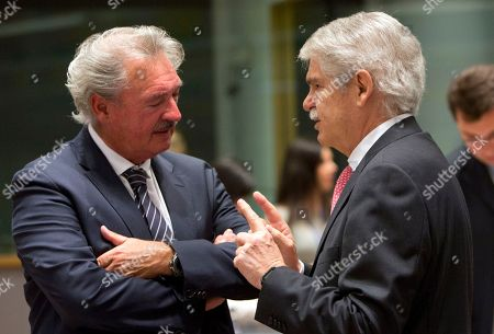 Spanish Foreign Minister Alfonso Dastis Quecedo, right, speaks with Luxembourg?s Foreign Minister Jean Asselborn during a meeting of EU foreign ministers at the Europa building in Brussels on . EU foreign ministers on Monday were seeking to protect the bloc's strategic and economic interests in Iran in the wake of the U.S. withdrawal from the international nuclear deal