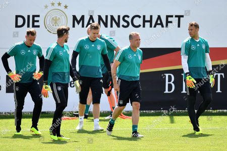 German goalkeepers Marc-Andre ter Stegen (L), Kevin Trapp (2-L), Bernd Leno (C), Manuel Neuer (R) and goalkeeper coach Andreas Koepke (2-R) attend a training session in Eppan, Italy, 28 May 2018. The German squad prepares for the upcoming FIFA World Cup 2018 soccer championship in Russia at a training camp in Eppan, South Tyrol, until 07 June 2018.
