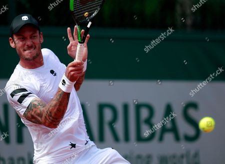 Andreas Haider-Maurer of Austria in action against Karen Khachanov of Russia during their men?s first round match during the French Open tennis tournament at Roland Garros in Paris, France, 28 May 2018.
