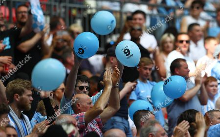Coventry City fans release balloons in memory of Cyrille Regis