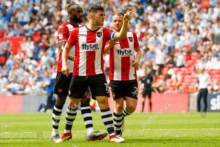 Exeter City ddefender Jordan Moore-Taylor (15) and Exeter City goalkeeper Christy Pym (1) have serious words during the EFL Sky Bet League 2 play-off final match between Coventry City and Exeter City at Wembley Stadium, London. Picture by Simon Davies