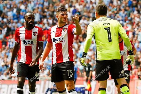 Exeter City ddefender Jordan Moore-Taylor (15) has serious words with Exeter City goalkeeper Christy Pym (1)  during the EFL Sky Bet League 2 play-off final match between Coventry City and Exeter City at Wembley Stadium, London. Picture by Simon Davies