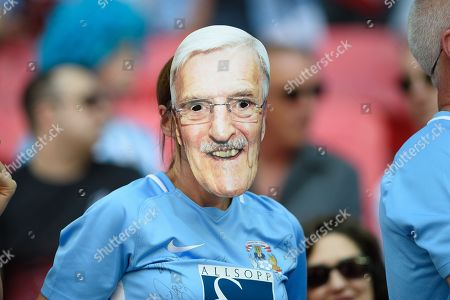 Coventry City supporter with Jimmy Hill mask during the EFL Sky Bet League 2 play-off final match between Coventry City and Exeter City at Wembley Stadium, London. Picture by Jon Hobley