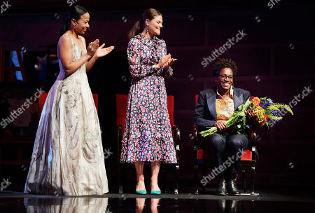 Swedish Culture and Democracy Minister Alice Bah Kuhnke (L) and Crown Princess Victoria (C) applaud American author Jacqueline Woodson (R), laureate of the 2018 Astrid Lindgren Memorial Award (ALMA) during the award ceremony at the Stockholm Concert Hall, in Stockholm, Sweden, 28 May 2018.