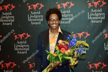 American author Jacqueline Woodson, laureate of the 2018 Astrid Lindgren Memorial Award (ALMA) poses for photographers holding flowers after the award ceremony at the Stockholm Concert Hall, in Stockholm, Sweden, 28 May 2018.