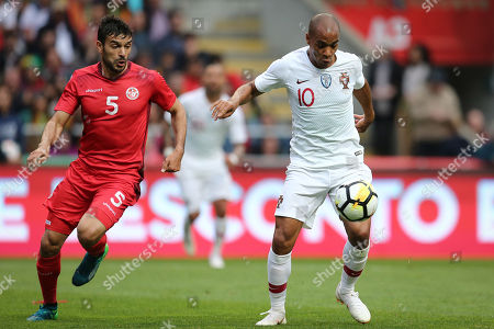 Joao Mario (R) of Portugal fights for the ball with Tunisia player Oussama Haddadi during the friendly soccer match between Portugal and Tunisia in Braga, Portugal, 28 May 2018.