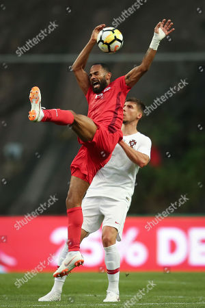 Ruben Dias (R) of Portugal fights for the ball with Tunisia player Saber Khalifa (L) during the friendly soccer match between Portugal and Tunisia in Braga, Portugal, 28 May 2018.