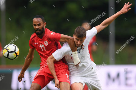 Portugal?s Ruben Dias (R) in action against Tunisia?s Saber Khalifa (L) during the friendly soccer match between Portugal and Tunisia in Braga, Portugal, 28 May 2018.