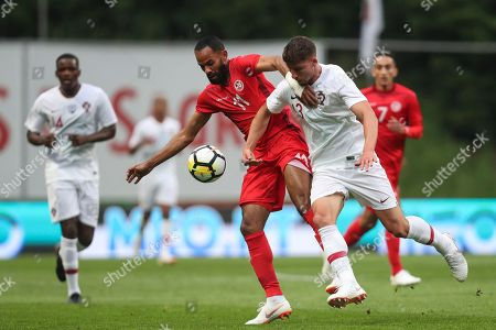 Tunisia's Saber Khalifa, center left, fights for the ball with Portugal's Ruben Dias during a friendly soccer match between Portugal and Tunisia in Braga, Portugal