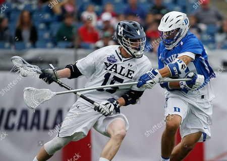 Stock Image of Jackson Morrill, John Prendergast. Duke's John Prendergast, right, defends against Yale's Jackson Morrill (15) during the first half of an NCAA college Division I championship final lacrosse game, in Foxborough, Mass