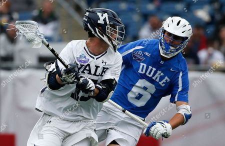 Stock Picture of Jackson Morrill, John Prendergast. Duke's John Prendergast (6), right, defends against Yale's Jackson Morrill (15) during the first half of an NCAA college Division I championship final lacrosse game, in Foxborough, Mass