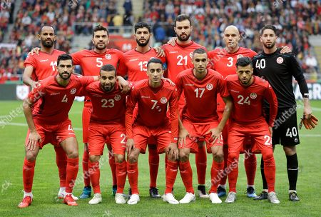 The Tunisia team poses for photos before a friendly soccer match between Portugal and Tunisia in Braga, Portugal, . Players are, on back row, from left to right, Saber Khalifa, Oussema Haddadi, Farjani Sassi, Hamdi Naguez, Yohan Ben Olouane and goalkeeper Moez Hassen. And on front row, Yassine Meriah, Naim Sliti, Seifeddine Khaoui, Elyes Skhiri and Anice Badri