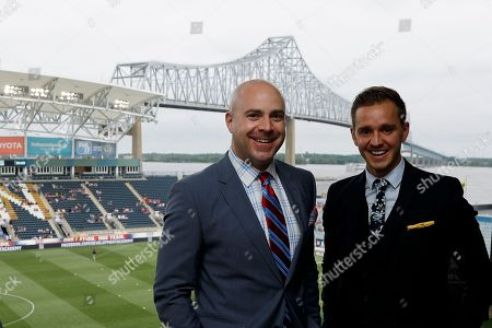 Fox Sports broadcasters Stuart Holden, right, and John Strong pose for a photo before an international friendly soccer match between the United States and Bolivia, in Chester, Pa