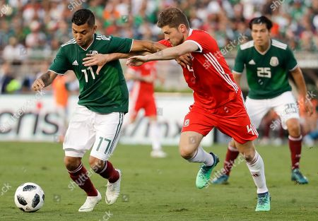 Wales' Ben Davies, right, battles for the ball with Mexico's Jesus Manuel Corona during the second half of their soccer match in Pasadena, Calif. The match ended in a 0-0 tie